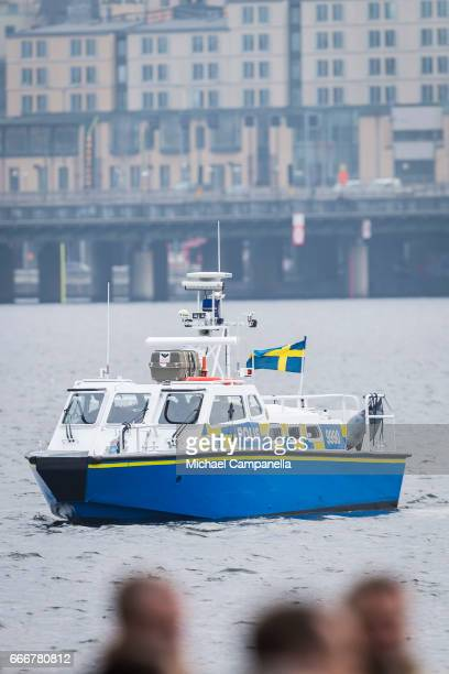 A police boat patrols the waters outside of Stockholm city hall during the city of Stockholm's official ceremony for the victims of the recent...