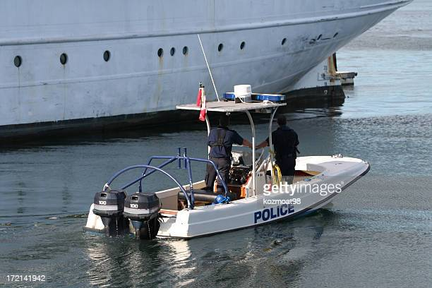 Police boat with two officers patrolling the harbour