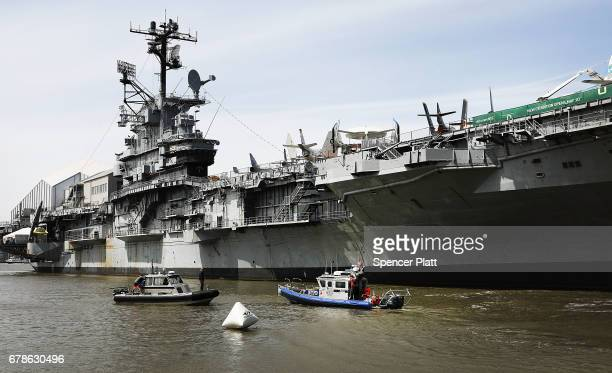 Police boats guard the USS Intrepid where President Donald Trump is scheduled to host Australian Prime Minister Malcolm Turnbull later today on May 4...