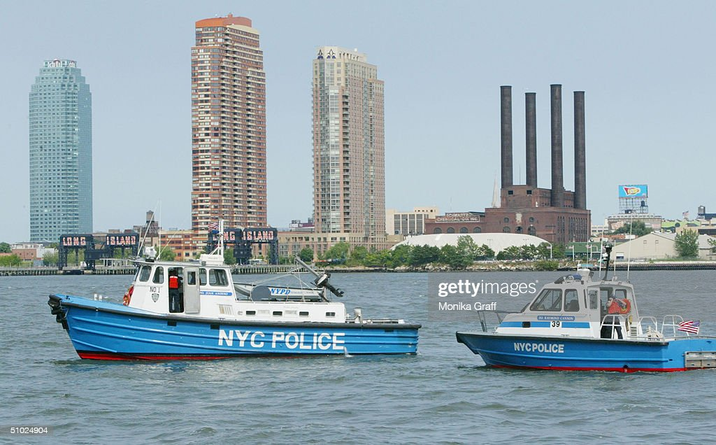 Police boats patrol the East River, where later in day the barges used for a fireworks display will be situated as security is beefed up July 4, 2004 in New York City. Although no specific threats have been sited the FBI has sent alerts to police departments nationwide for the holiday weekend.
