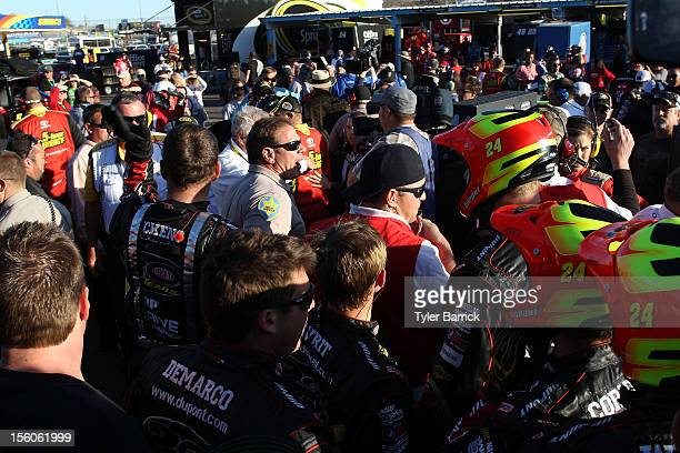 Police break up fights in the garage area after an ontrack incident with Clint Bowyer driver of the 5hour Energy Toyota and Jeff Gordon driver of the...