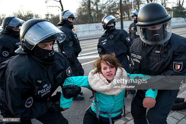 Police break up groups of demonstrators during a protest against a NeoNazi march on January 18 2014 in Magdeburg Germany According to police 700...