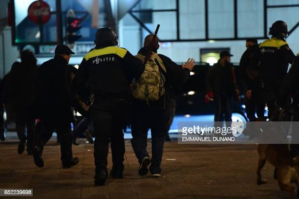 Police break up protests that erupted after Dutch authorities barred Turkish ministers from visiting early March 12 2017 in Rotterdam After initially...