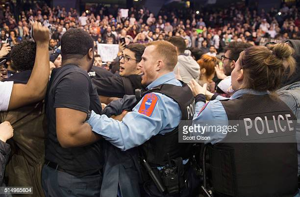 Police break up skirmishes between demonstrators and supporters of Republican presidential candidate Donald Trump that broke out after it was...