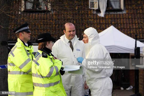Police by the scene Wednesday March 2006 of where a man who was shot and killed in the doorway of 292 Point Clear Road Osyth Essex Officers suspect...