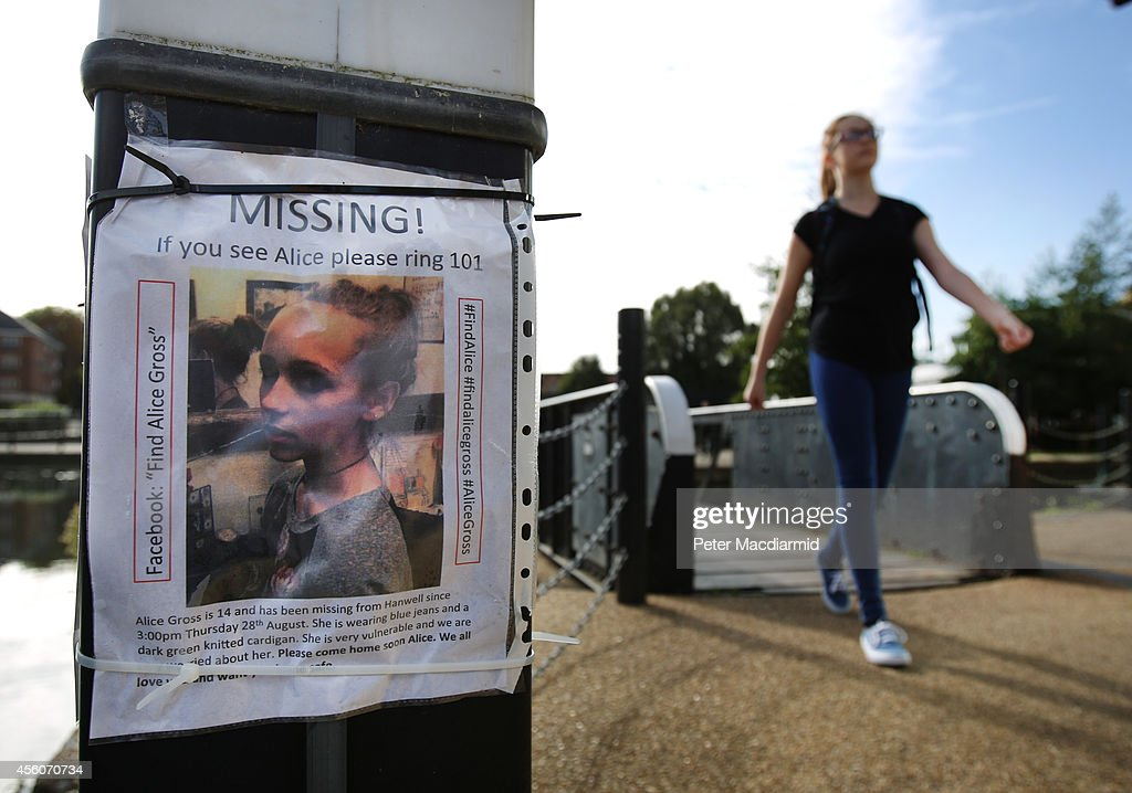 A police cadet reconstructs the last known movements of missing schoolgirl Alice Gross - seen here walking past a missing poster placed by friends and family at Brentford Lock on September 25, 2014 in London, England. The hunt for Alice Gross from Hanwell, who went missing on August 28, is now being described as the largest police search operation since the 7/7 bombings of 2005. The police inquiry is now focused on a key suspect, Arnis Zalkalns, a Latvian builder, who was seen in the vicinity of Alice's last sighting.