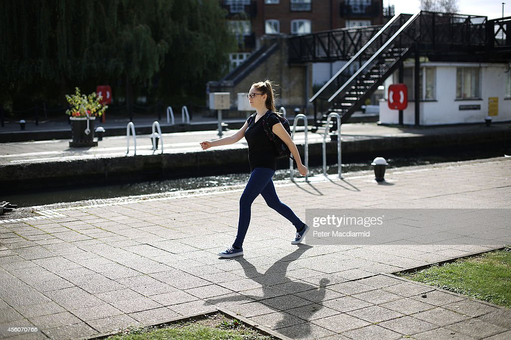 A police cadet reconstructs the last known movements of missing schoolgirl Alice Gross - seen here walking at speed past Brentford Lock on September 25, 2014 in London, England. The hunt for Alice Gross from Hanwell, who went missing on August 28 is now being described as the largest police search operation since the 7/7 bombings of 2005. The police inquiry is now focused on a key suspect, Arnis Zalkalns, a Latvian builder, who was seen in the vicinity of Alice's last sighting.
