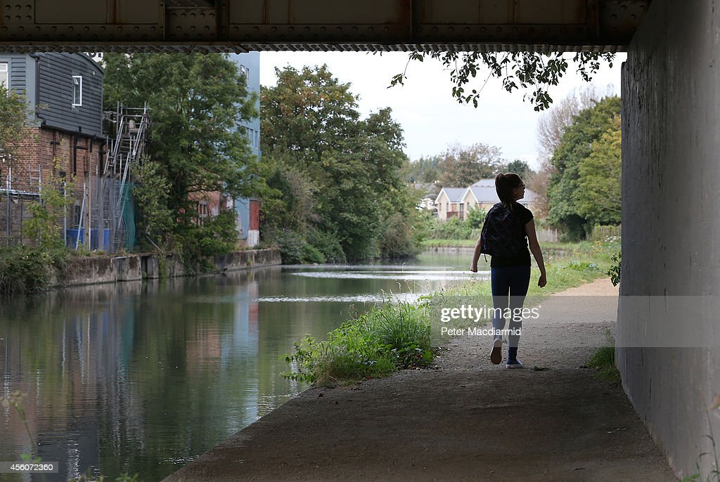 A police cadet reconstructs the last known movements of missing schoolgirl Alice Gross - here she walks under a bridge on the Grand Union Canal - the location of her last sighting, on September 25, 2014 in London, England. The hunt for Alice Gross from Hanwell, who went missing on August 28, is now being described as the largest police search operation since the 7/7 bombings of 2005. The police inquiry is now focused on a key suspect, Arnis Zalkalns, a Latvian builder, who was seen in the vicinity of Alice's last sighting.