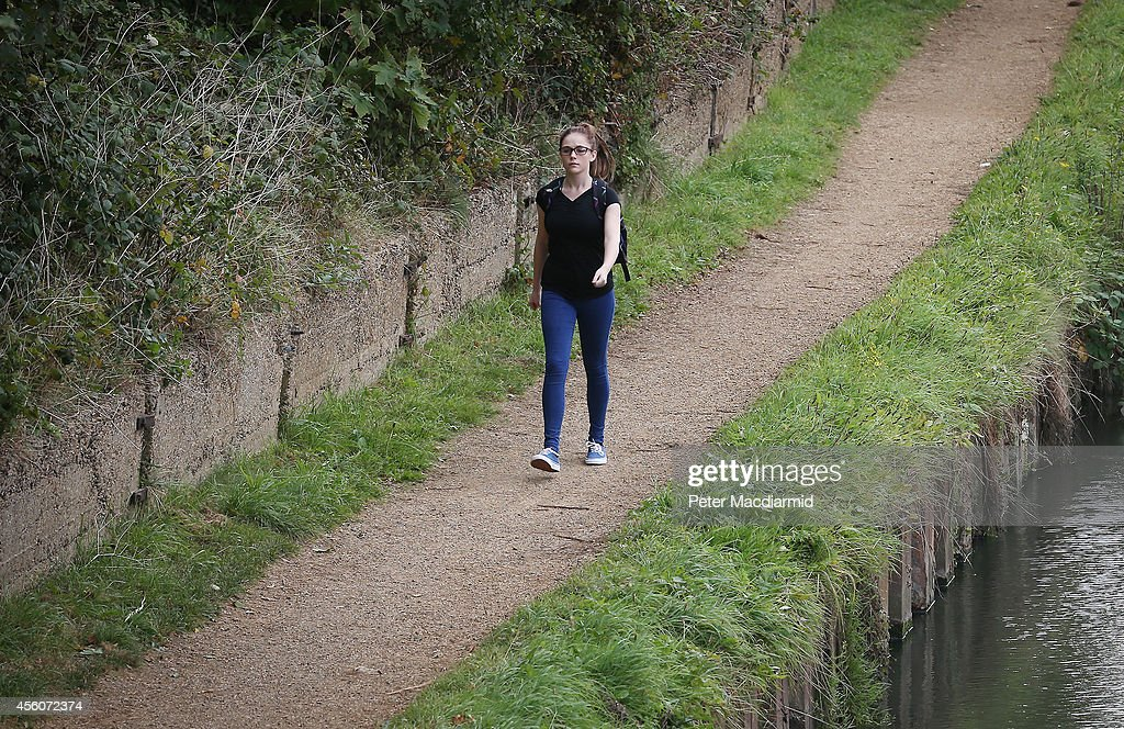 A police cadet reconstructs the last known movements of missing schoolgirl Alice Gross - here she walks next to the Grand Union Canal - the location of her last sighting, on September 25, 2014 in London, England. The hunt for Alice Gross from Hanwell, who went missing on August 28, is now being described as the largest police search operation since the 7/7 bombings of 2005. The police inquiry is now focused on a key suspect, Arnis Zalkalns, a Latvian builder, who was seen in the vicinity of Alice's last sighting.