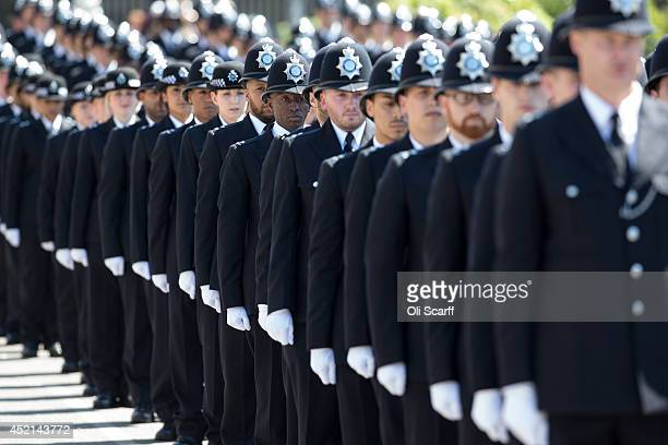 Police cadets who have completed their training take part in their 'Passing Out Parade' in the grounds of West Ham United Football Club on July 14...