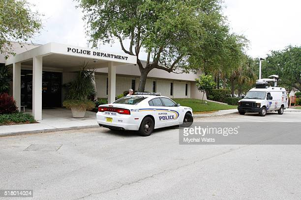 A police car and TV truck sit outside the police department on March 29 2016 in Jupiter Florida Donald Trump's campaign manager Corey Lewandowski has...