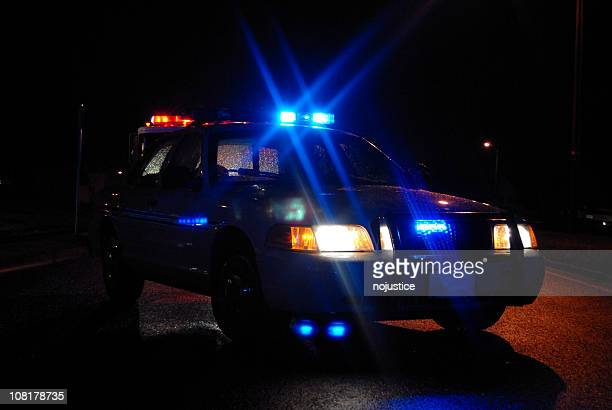 Police Car at Night with Lights On