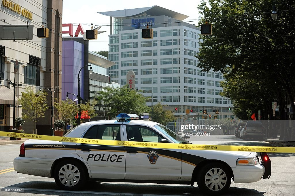 A police car blocks a road near the Discovery Channel headquarters in Silver Spring Maryland on September 1 2010 A gunman fired several shots and...