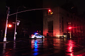 A police car blocks access to Broadway after the neighborhood lost power Hurricane Sandy caused major power outages throughout much of Lower Manhattan