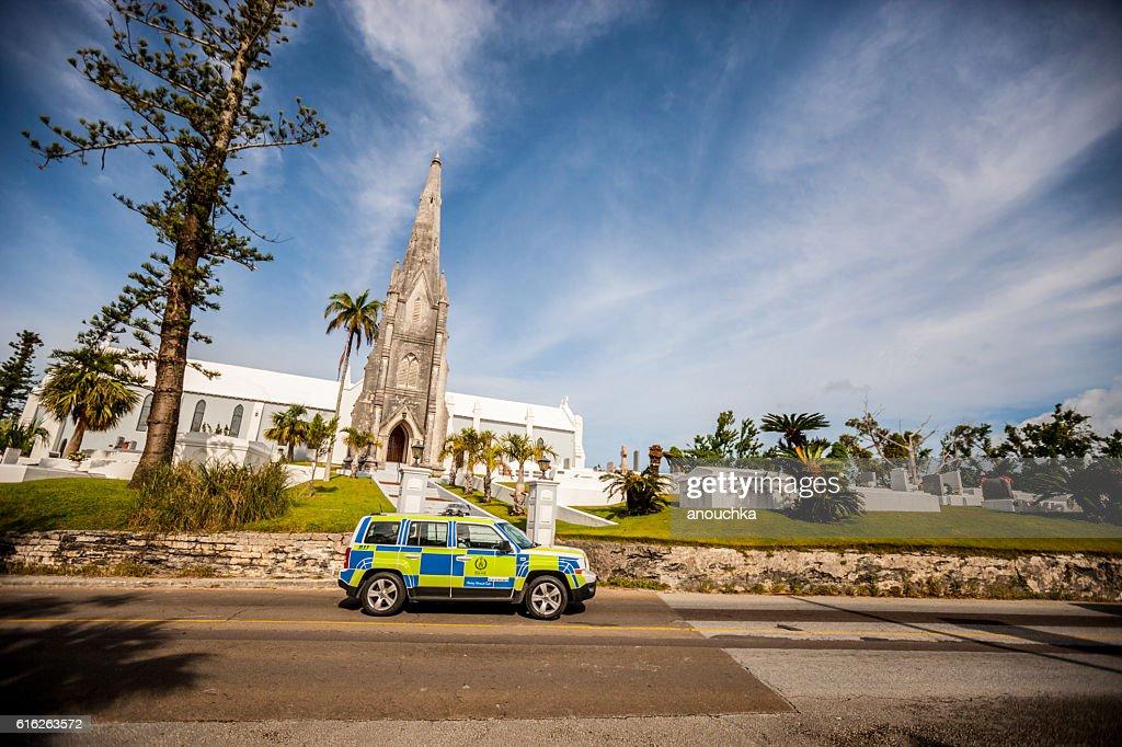 Police car, Church and cemetery on Bermuda : Stock Photo