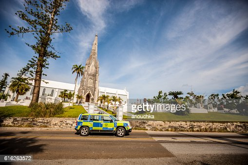 Police car, Church and cemetery on Bermuda : Stock Photo