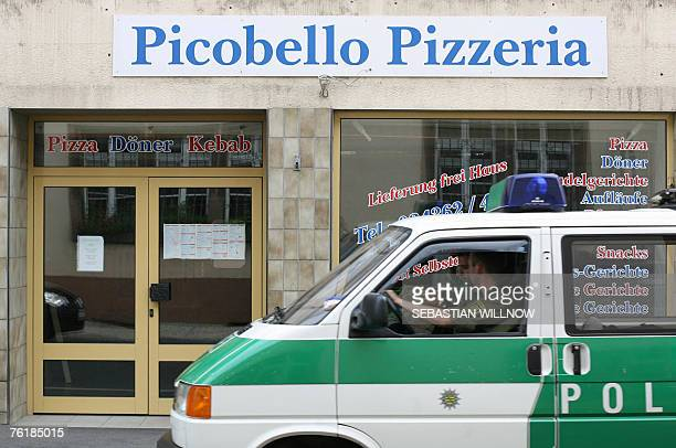 A police car drives past a pizza parlour 20 August 2007 in Muegeln eastern Germany German police said they believed farright motives could be behind...