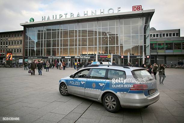 Police car drives pasta train station of Cologne on January 5 2015 Some 20 women reported sexual assaults by men on New Year's Eve at the city's...