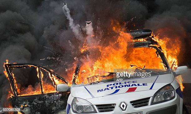 TOPSHOT A police car explodes after being set on fire during an unauthorized counterdemonstration against police violence on May 18 2016 in Paris as...