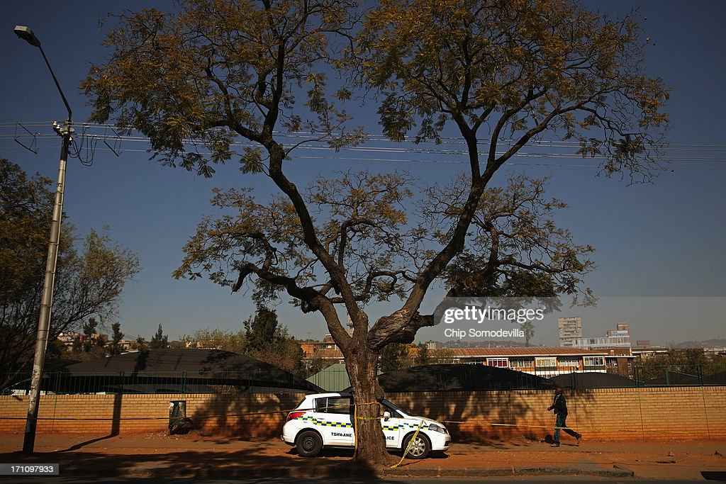 A police car finds a sliver of shade while parked outside the Mediclinic Heart Hospital where former South African President Nelson Mandela, 94, is being treated for a recurring lung infection June 22, 2013 in Pretoria, South Africa. The Nobel Peace Prize laurete and anti-aparteid icon has been in hospital for two weeks in 'serious but stable' condition, according to the South African government.