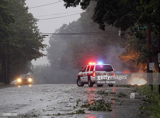 A police car guards a fire that was ignited by a fallen live electric wire on Old Bethpage Road on August 28 2011 in Old Bethpage New York Hurricane...