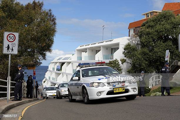 A police car heads a motorcade leaving Bondi Icebergs carrying the partners of economic leaders following the APEC spouses' lunch on September 9 2007...
