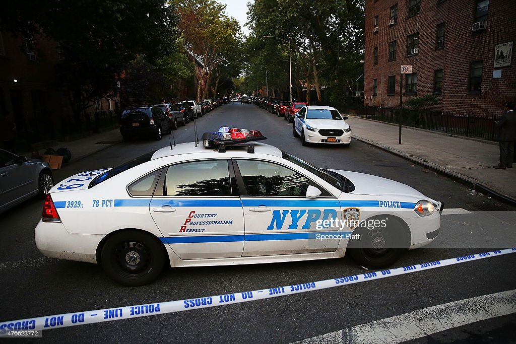 A police car is parked at a crime scene where three people were shot on June 10 2015 in the Gowanus area of the Brooklyn Borough of New York City In...