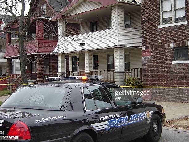 A police car is parked before the residence of 50yearold convicted rapist and alleged serial killer Anthony Sowell on November 4 2009 in Cleveland...