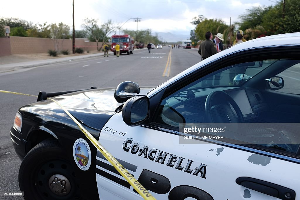 A police car is parked near the Islamic Society of Palm Springs in Coachella California on December 11 after the area was sealed off when a fire...