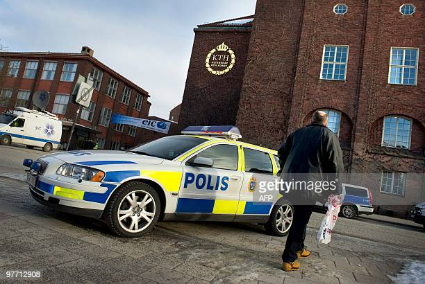 A police car is parked on March 15 2010 outside the Royal Institute of Technology in Stockholm Police said on March 15 they had detained a 33yearold...