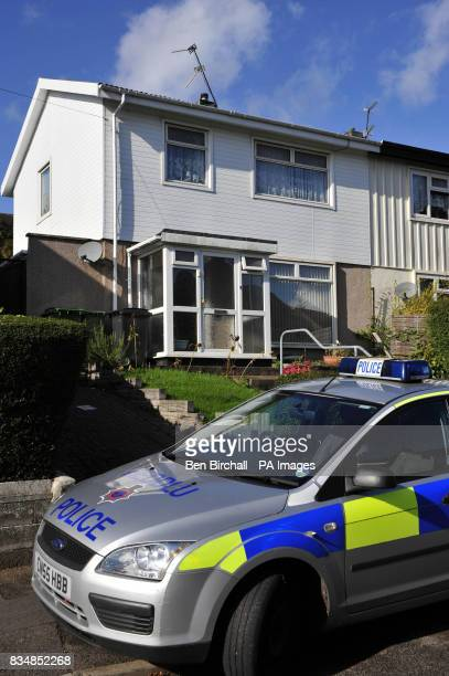 A police car is parked outside a house in Rumney Cardiff as police continue to question a 52yearold man on suspicion of murder after the death of...