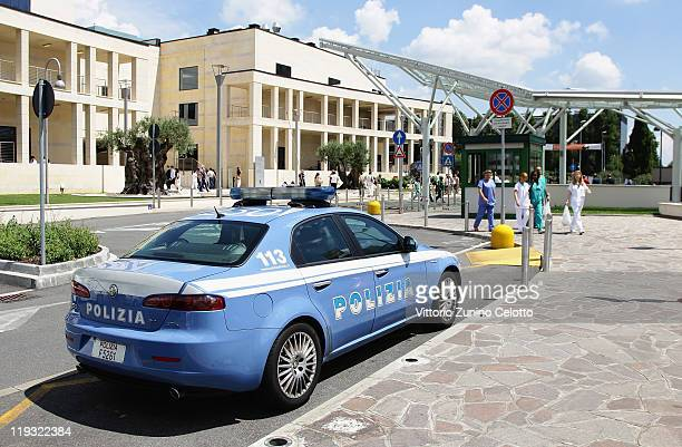 A police car is parked outside the San Raffaele Hospital on July 18 2011 in Milan Italy San Raffaele Hospital founder Mario Cal committed suicide by...