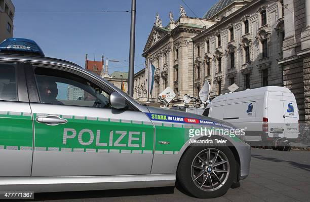 A police car is pictured in front of the justice palace court house where the trial of Bayern Muenchen president Ulrich Hoeness takes place on March...