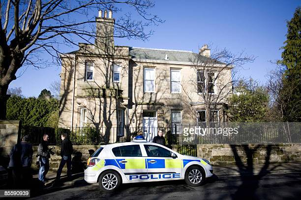 A police car is pictured outside a home of former Royal Bank of Scotland Chief Executive Sir Fred Goodwin in Edinburgh Scotland on March 25 2009...