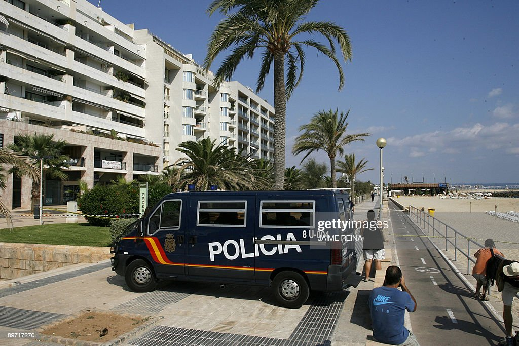 A police car is seen in Can Pere Antoni's beach Palma de Mallorca on August 9 2009 after a bomb exploded in a restaurant following a telephoned...