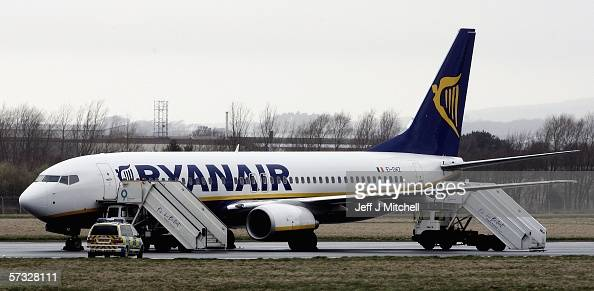 A police car is seen next to a Ryanair plane on the runway at Prestwick Airport on April 12 2006 in Prestwick Scotland The Ryanair Flight travelling...