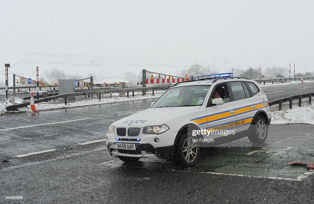 A police car is seen on patrol as heavy snowfall causes the closure of the A66 on March 22, 2013 in Bowes, United Kingdom. Heavy snow is causing disruption to transport and schools across the UK in the coldest March the country has seen for decades, with no sign of the warm spring weather that Britain enjoyed this time last year. Homes have been left without power in Northern Ireland, airports shut and flooding in parts of Devon and Cornwall.
