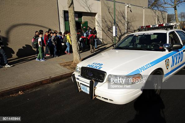 A police car is viewed in front of the Peter Rouget Brooklyn middle school as children are let back in following reports of a bomb threat on December...