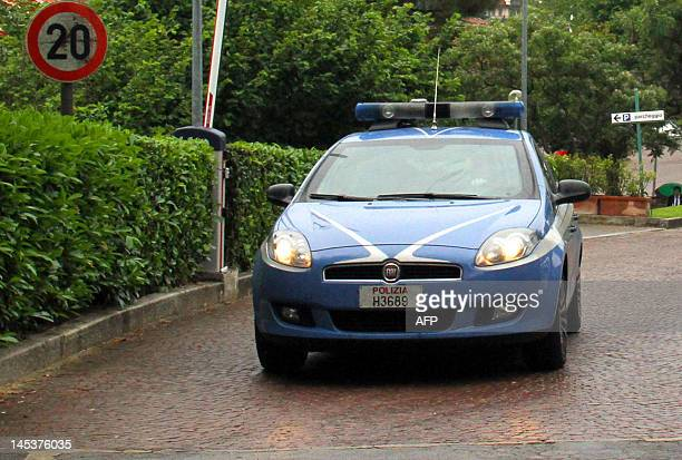 A police car leaves the national technical football training center of Coverciano in Florence on May 28 2012 National team defender Domenico...