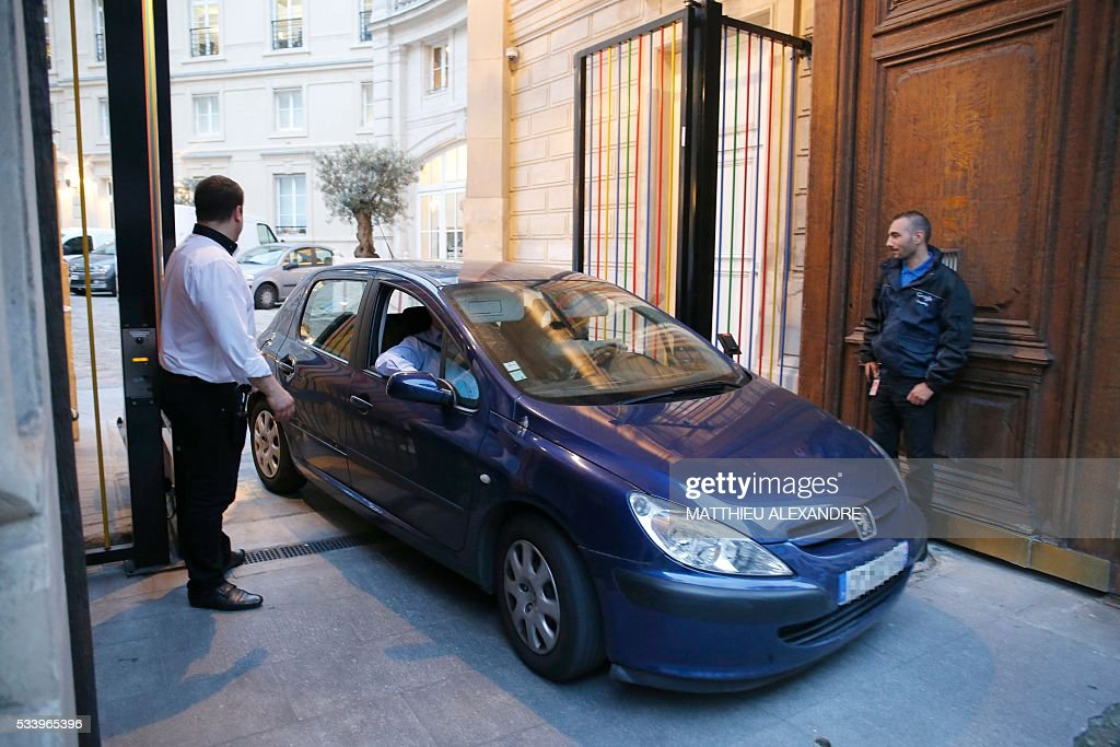 A police car leaves the Paris offices of US Internet giant Google on May 24, 2016, in Paris, as police carry out a search as part of a tax fraud investigation. French authorities believe Google owes 1,6 billion euros (USD 1,7 billion) in back taxes, a source close to the matter said in February. Google is one of several multinational corporations that have come under fire in Europe for paying extremely low taxes by shifting revenue across borders in an often complex web of financial arrangements.
