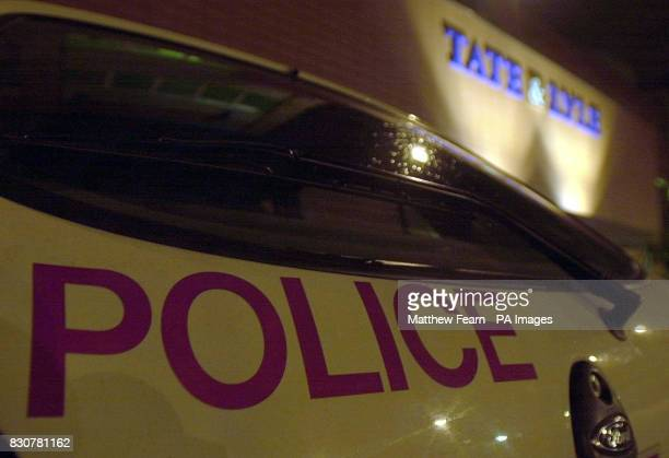 A Police car outside the main reception of the Tate Lyle sugar refinery in Silvertown North Woolwich London Antiterrorist officers were searching a...