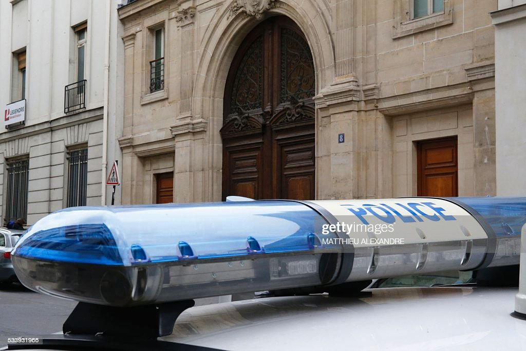 A police car outside the Paris offices of US Internet giant Google on May 24, 2016, in Paris, as police carry out a search as part of a tax fraud investigation. French authorities believe Google owes 1,6 billion euros (USD 1,7 billion) in back taxes, a source close to the matter said in February. Google is one of several multinational corporations that have come under fire in Europe for paying extremely low taxes by shifting revenue across borders in an often complex web of financial arrangements.