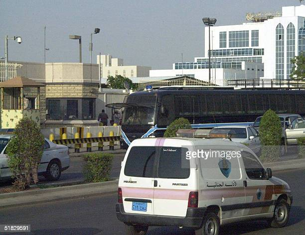 A police car passes the US consulate in the Saudi Red Sea city of Jeddah 06 December 2004 Gunmen suspected of links to AlQaeda stormed the US...