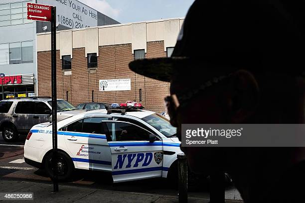 A police car patrols an area which has witnessed an explosion in the use of K2 or 'Spice' a synthetic marijuana drug in East Harlem on September 02...