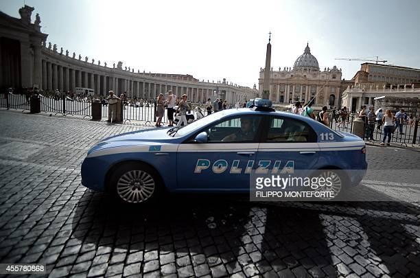 A police car patrols around Saint Peter's Square at the Vatican on September 20 2014 Security has been tightened in Saint Peter's Square after...