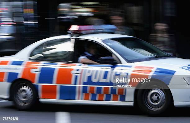 A police car patrols up Queen Street April 03 2007 in Auckland New Zealand Dame Margaret Bazley today released her Commission Of Inquiry Report into...