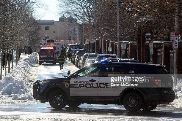 A police car seals off Quincy Street at Harvard University during a bomb scare December 16 2013 in Cambridge Massachusetts Police were alerted at...