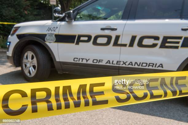 A police car secures the crime scene near a baseball field after a shooting in Alexandria Virginia on June 14 2017 Several people including a top...