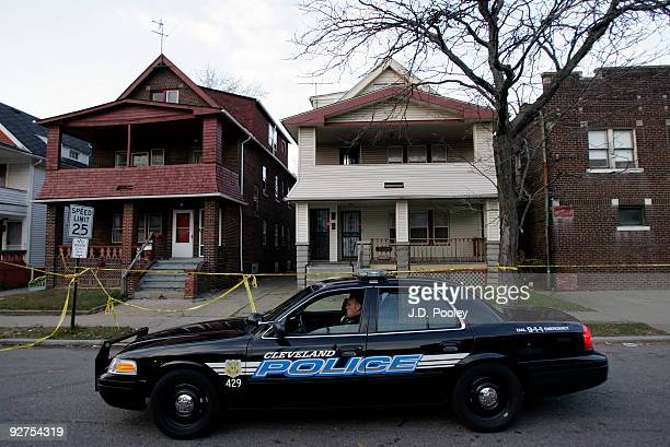 A police car sits outside the home of Anthony Sowell November 4 in Cleveland Ohio Sowell has been in jail since last week charged with murder rape...