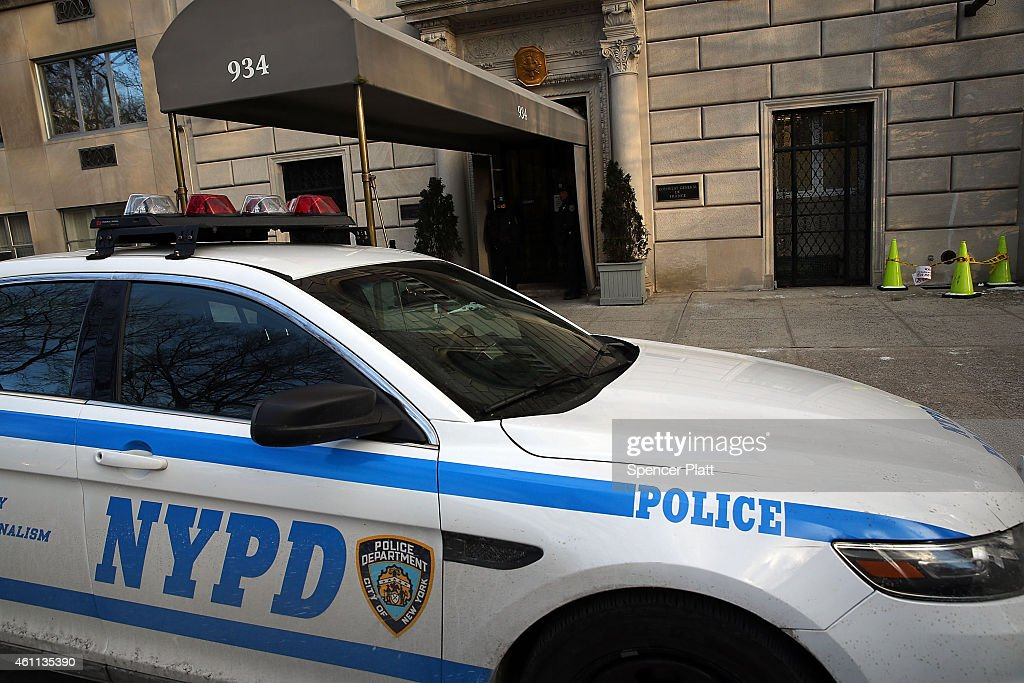 A police car sits parked outside of the French Consulate in Manhattan following terrorist attacks on a French satirical newspaper in Paris today on...